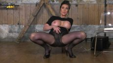 Miss Hybrid soaking wet nylons and high heels.